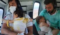 Bebeklerin kahramanı Helikopterde bir an olsun kucağından bırakmadı